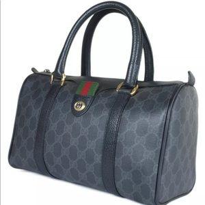 Authentic Gucci black coated canvas satchel bag